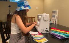 Junior Annie Robinson works on her colorful custom masks. She had the idea to sew masks to help slow the pandemic, make money and fill up her time.