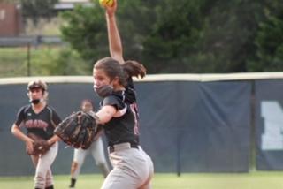 Freshman Stella Fredrick pitches against Northview High School. Grady lost in the last inning 10-11.