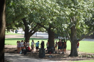 The cross country team talks to their coach about the practice ahead.