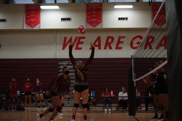 Senior+Carson+Gray+sets+junior+Jade+Lewis+up+for+a+spike+against+Tri+Cities+High+School.+The+Knights+won+by+a+score+of+2-1.
