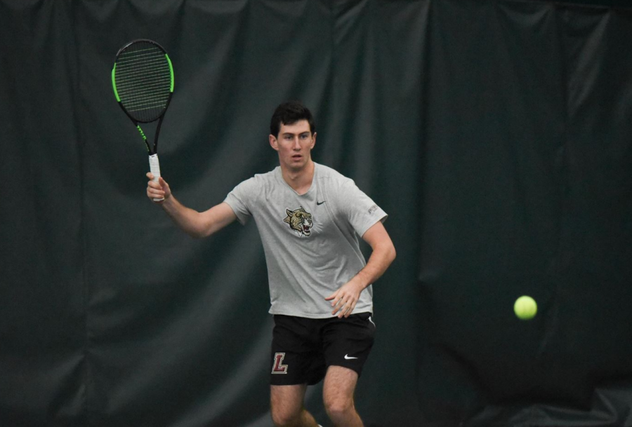Lafayette+College+freshman+Josh+Wolfe+prepares+to+hit+the+tennis+ball+during+a+morning+match+against+St.+Francis+College+on+Feb.+9.