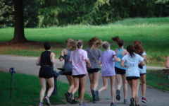 The girls cross country team runs through Piedmont park to prepare for their meets to come.