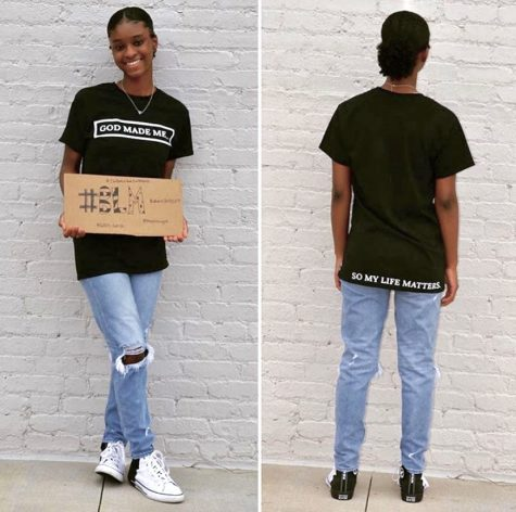 Swint poses with a Black Lives Matter sign to show her support. She shows the front and back design of one of her t-shirts.