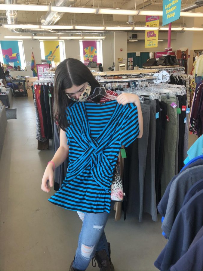 Junior Sophie Rice, co-founder of the sustainable fashion club, takes a stand against fast-fashion by only shopping sustainably at second-hand stores.