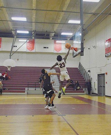 Senior Joseph Scott leaps to shoot a running layup in a game.