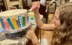 Freshman Virginia Laster sold her first cake on Mar. 20. Since then, she has sold approximately 20 more. Laster fully concentrates on every detail as she frosts the book decorations.