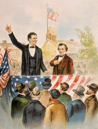 President Abraham Lincoln (left) and Senator Stephen Douglas (right) are illustrated in a depiction of the 1858 Lincoln-Douglas debates.  The debates were highly publicized and are regarded as one of the greatest American political debates.
