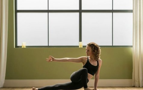 Senior Avery Forster holds the Horizons pose at Highland Yoga, a pose meant to open the hips and to strengthen the legs, arms, and spine.