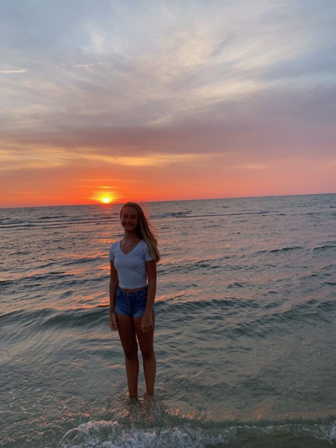 Freshman Grace Franetovich poses during sunset at the beach.