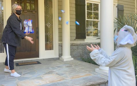 Noble Park resident tosses candy to a trick-or-treater, a method called