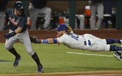 Shortstop Dansby Swanson is tagged out by Dodgers third baseman Justin Turner. The Braves lost in the NLCS to Los Angeles in a 7 game series.
