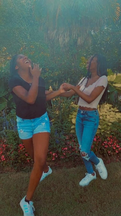 Sophomore Nylah Shepherd and her friend laugh after going out to lunch. She is very upset about festivals being cancelled, but she's finding ways to enjoy fall with friends.
