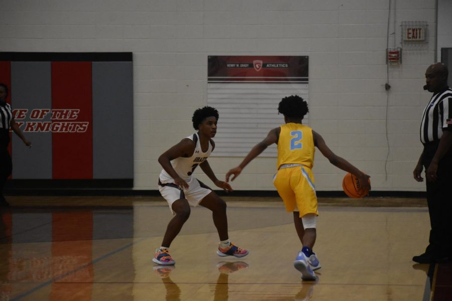 As the scrimmage against Mays on Nov. 17 grows closer in the fourth quarter, junior guard Kyle Hanson picks up the opposing teams guard at half-court as he pushes the ball down the court. The game would result in a 48-47 loss for the Knights.
