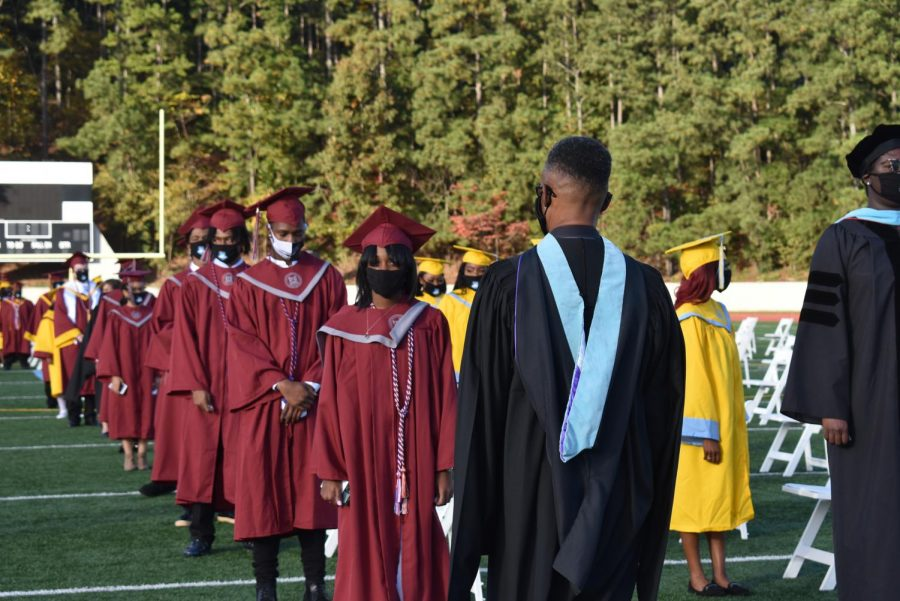 Assistant Principal Willie Vincent stands in front of the seven Grady graduates in attendance at the ceremony.