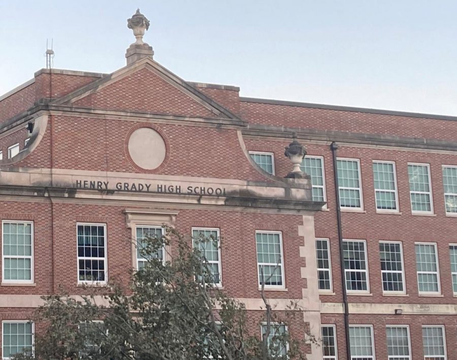 The Atlanta Board of Education voted to finalize Midtown High School as the new name for Henry W. Grady High School.