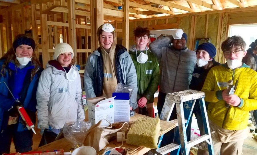 Members of Habitat for Humanity Club and G3 Robotics volunteered at a Habitat for Humanity build in February. Encouraging volunteering with a direct impact on the community should be the goal of the community service requirement, not just simply filling the hours.