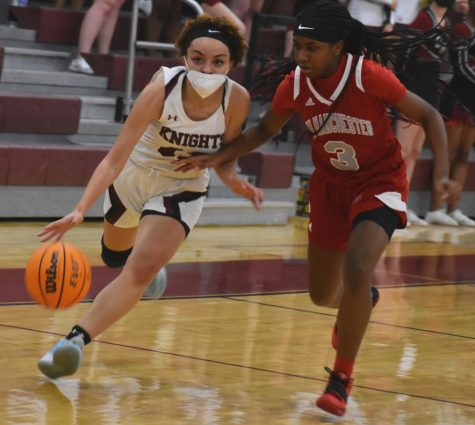 Senior Trinity Lewis drives the ball to the basket in a home game against New Manchester on Dec. 11.
