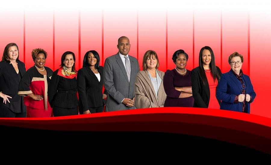 The Atlanta Board of Education (From Left): Leslie Grant (District 1), Aretta L. Baldon (District 2), Michelle D. Olympiadis (District 3), Vice-Chair Eshe' P. Collins (District 6), Chair Jason Esteves (Seat 9), Nancy M. Meister (District 4), Erika Y. Mitchell (Seat 5), Kandis Wood Jackson (Seat 7), Cynthia Briscoe Brown (Seat 8). The Board will hold their final meeting before the Jan. 5 runoff elections on Monday, Dec. 7.