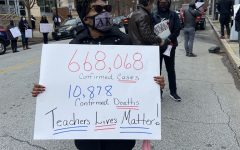 Protester holds up a sign displaying the amount of confirmed cases and confirmed deaths in Georgia. Teachers and staff protested at the Atlanta Public Schools district office in downtown Atlanta for the 2020-2021 school year to remain virtual, unless COVID cases go down.