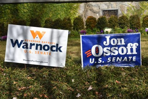 Campaign signs supporting Senator-elect Raphael Warnock and Senate candidate Jon Ossoff dot the lawns of houses in the Grady community.