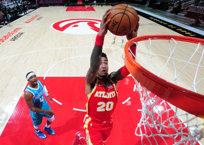 John Collin finishes with a slam in a loss against the Hornets on Jan. 9 Credit: nba.com