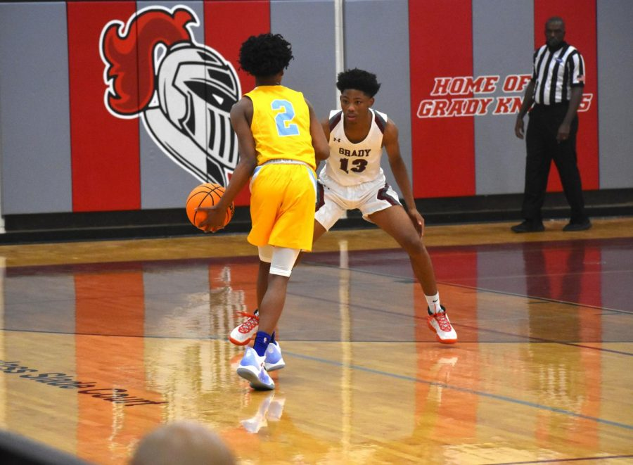 Junior Samari Barnwell defends a Mays High School guard in their scrimmage on Nov. 17. The Knights lost the scrimmage  48-47.