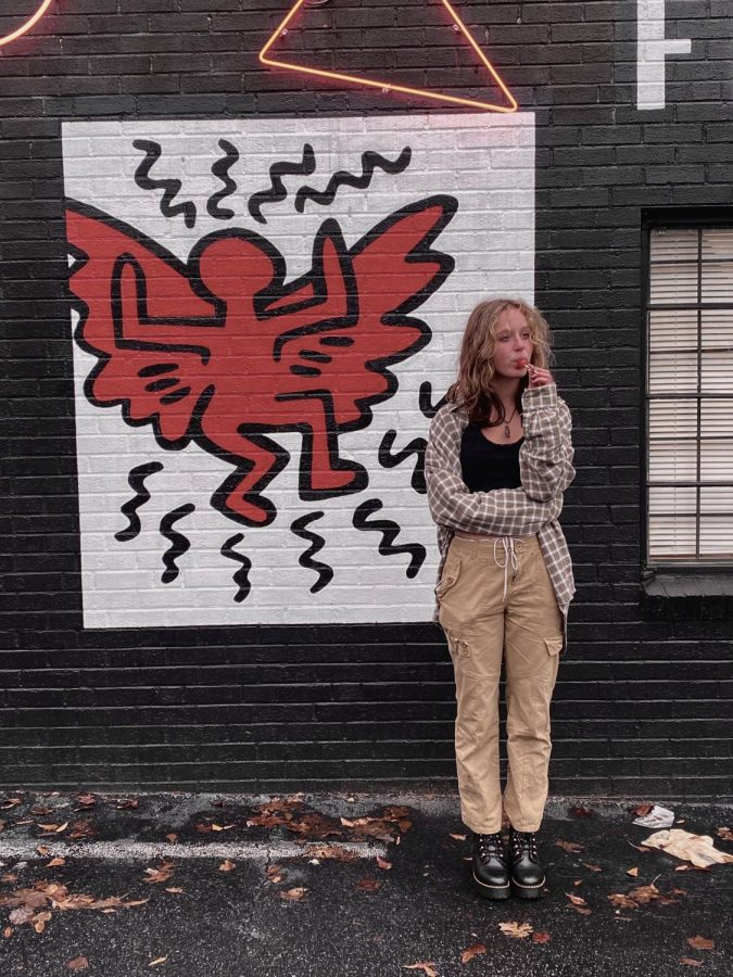 Carter poses in front of a small mural in Atlanta.