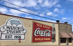 The iconic Coca-Cola mural serves as an eye-catching signal to remind those who pass by that Manuel's Tavern is the perfect place to grab a quick meal. The mural, repainted last year, is a recognizable and charming aspect of the restaurant's history.