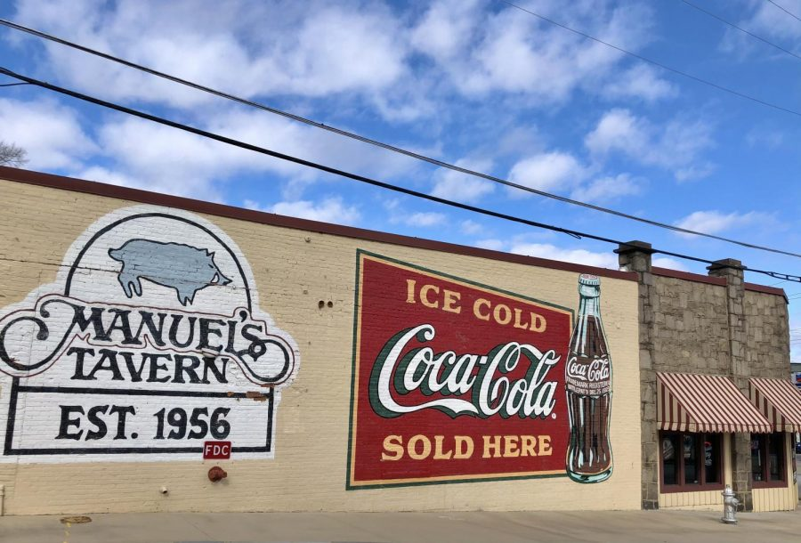 The+iconic+Coca-Cola+mural+serves+as+an+eye-catching+signal+to+remind+those+who+pass+by+that+Manuel%27s+Tavern+is+the+perfect+place+to+grab+a+quick+meal.+The+mural%2C+repainted+last+year%2C+is+a+recognizable+and+charming+aspect+of+the+restaurant%27s+history.