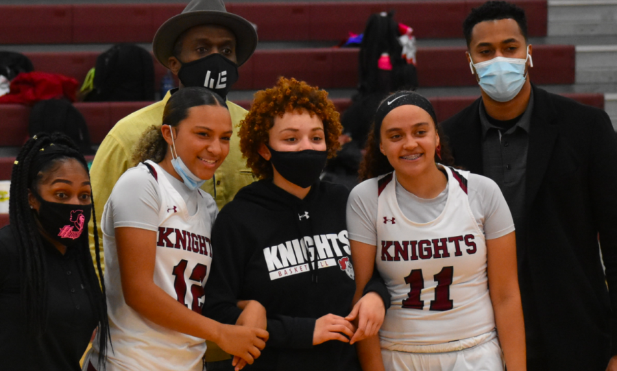 LEFT TO RIGHT: Dana Smith, Jade Lewis, Dhati Lewis, Trinity Lewis, Briaiah Lewis, and Roderick Hill come together to celebrate Trinity's senior night on Jan. 29th.