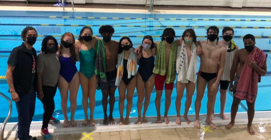 The Grady swim team is seen consoling with each other following a practice. In the GHSA state meet, the boys finished 8th and the girls 9th, respectively.