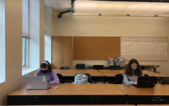 Students sit in the E200 Core Lab, where all the computers have been removed to allow for social distancing.