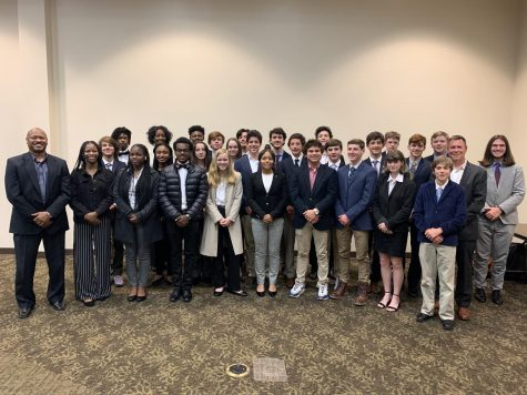 The DECA team smiles for a picture at the 2019 regional competition.