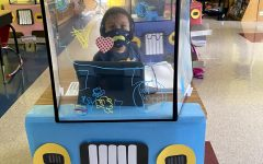 DeAndre Mahone Jr., a kindergartener at Hope Hill Elementary school, works at his classroom desk. His teacher decorated her students' desk shields like cars.