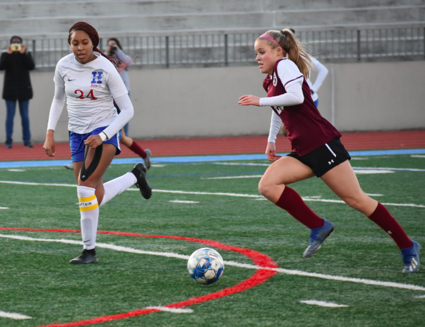 Sophomore Maddie Shaw dribbles the ball up the field. The Knights are 3-0 in their region matches so far this season.