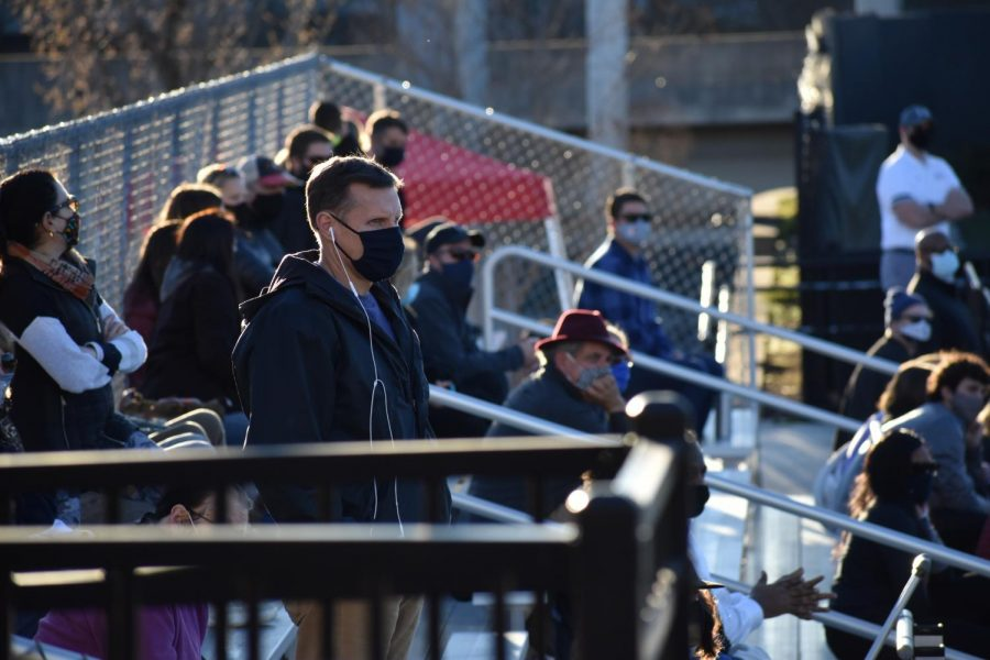 Parents and students watch the varsity girls lacrosse game against North Springs on March 3. The Knights won 17-1. As a part of the new restrictions, only 100 spectators are allowed at each event, and masks and temperature checks are required.