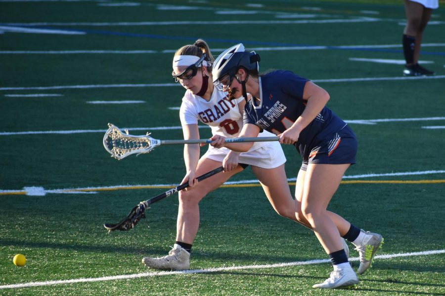 Senior Katie Dwyer fights for a ground ball after a faceoff against North Springs on Mar. 3. The Knights beat North Springs 17-1.