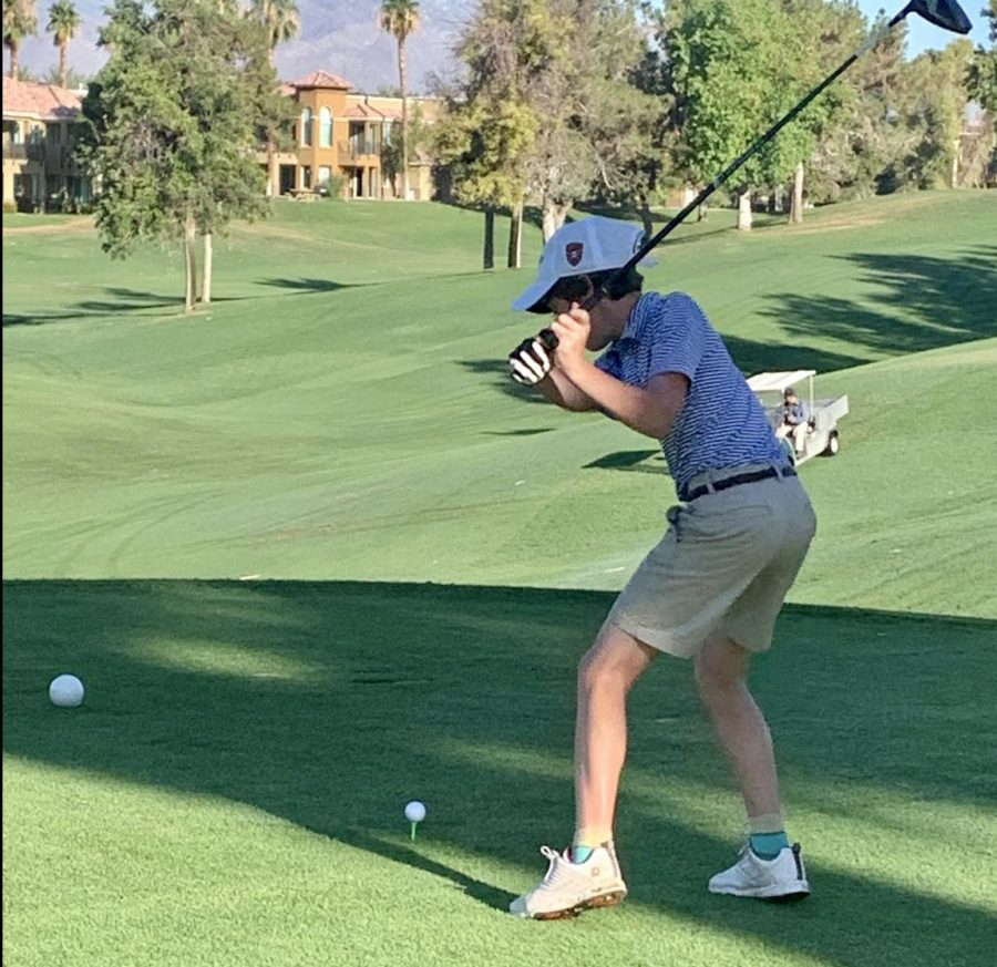 Sophomore+Riley+Ruby+swings+to+hit+a+golf+ball+during+a+tournament.
