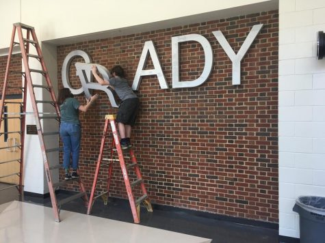 Student volunteers disassemble the Grady sign in the theatre lobby. The rebranding advisory team has finished conducting community listening sessions and has now opened up submissions for logo design. The first round of submissions should be submitted to John Brandhorst at jbrandhorst@atlanta.k12.ga.us by March 14.