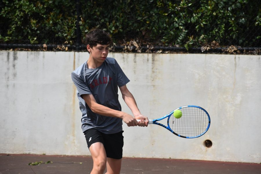 Sophomore Ethan Bass practices with head tennis coach Val Taylor on March 30. Bass also practices outside of school with the Universal Tennis Academy and competes nationally through the United States Tennis Association.