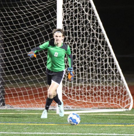 Sophomore JV boys soccer goalie Will Hunter prepares to clear the ball during a scrimmage against Pace Academy on Jan. 30.