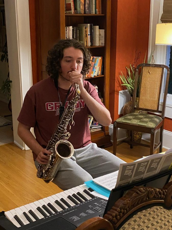 Tanner Lamar practices the saxophone at home.