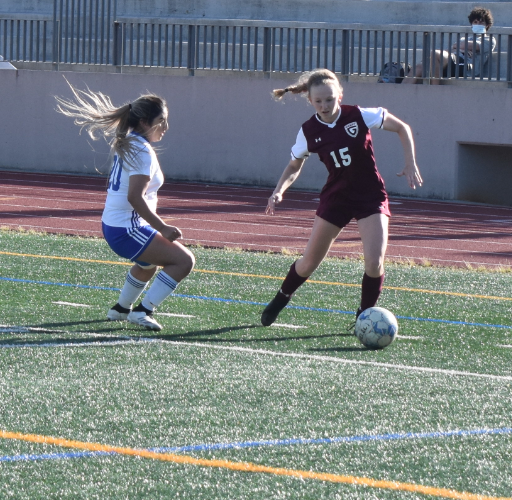 Senior girls soccer co-captain Elise Isakov dribbles past a defender during a first round playoff game against Cass on Wednesday, April 21. The Knights won 6-0.