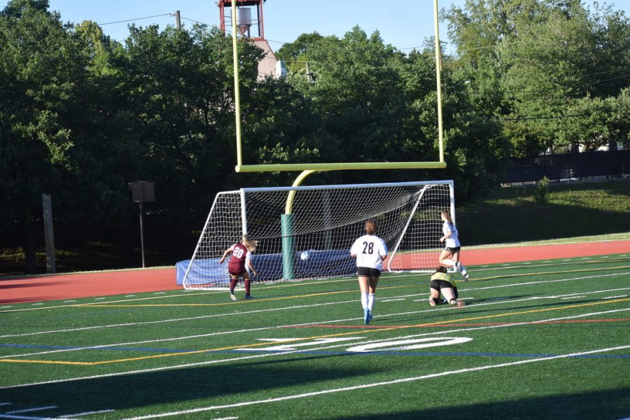 Sophomore forward Maddie Shaw scores off of a bad backward pass by a Starr's Mill defender.