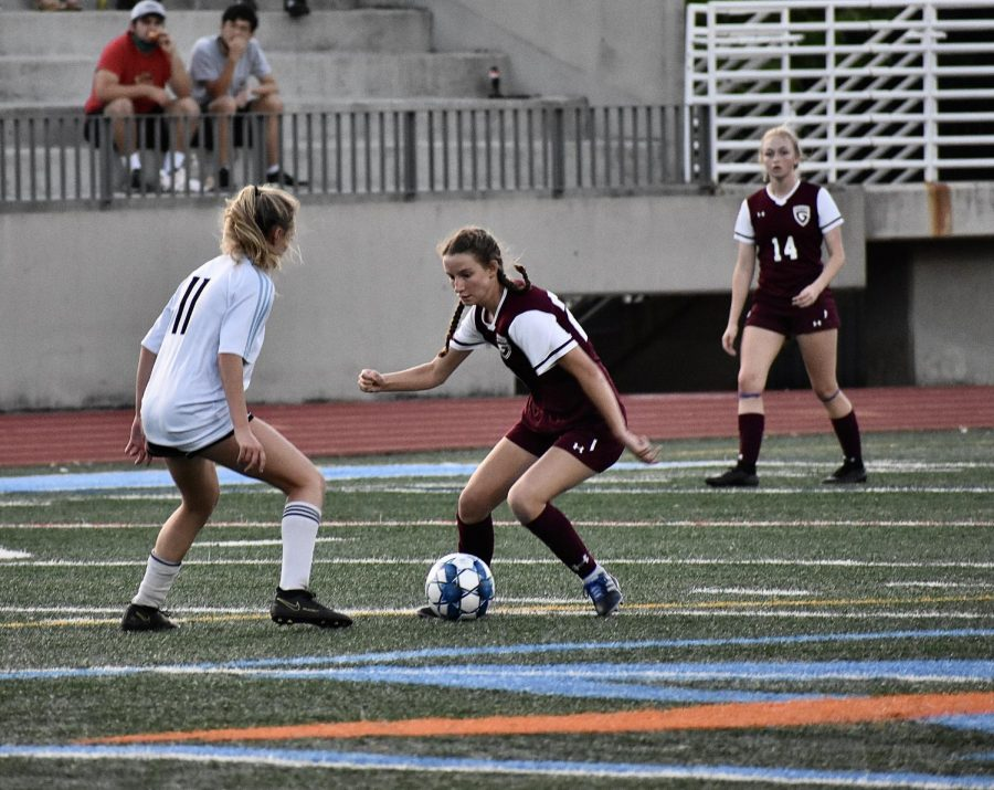 The Grady girls varsity soccer team faced off against Starr's Mill in the state quarterfinal, winning and advancing to the semifinal with a score of 3-1. Here, sophomore forward Shay Bowman makes a move to get around a Starr's Mill defender.