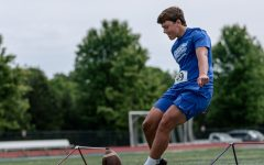 Junior Roswell Bond is seen kicking a field goal. Bond spent the summer kicking in college camps around the south.