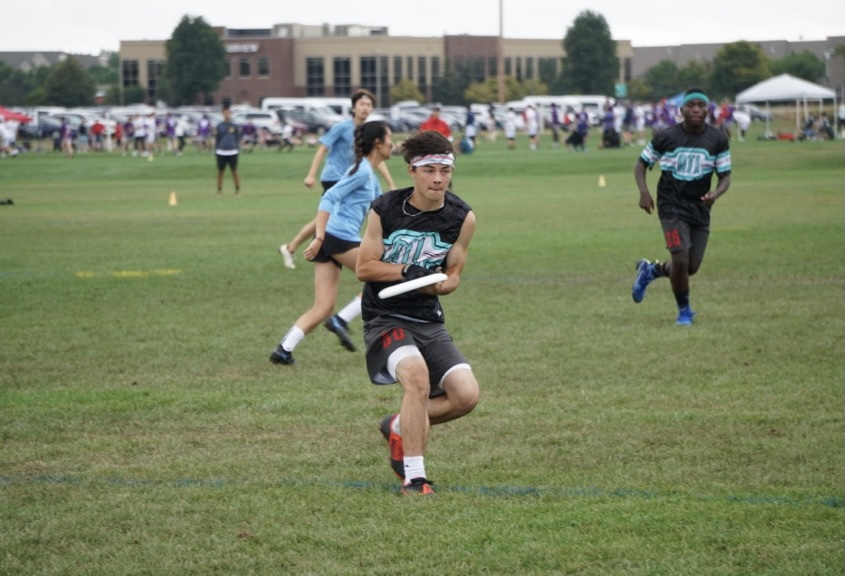 On the first day of the 2021 Youth Club Championships, senior Scott Whitley secures the disc in a pool-play game against Oregon Rapids, who Atlanta flATLine beat 15-8.