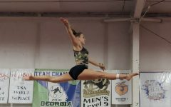 Sophomore gymnast Grace Tilley practices after school. Tilley said that the short length of leotards make her uncomfortable.