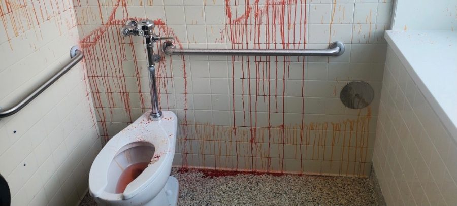 A student vandalized the boys C300 bathroom with red and orange pigment. Custodians were unable to remove the pigment from the flooring.