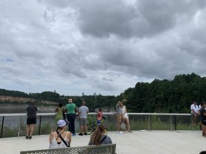 Visitors of the park look out over the Bellwood Quarry with a view of the Atlanta Skyline.